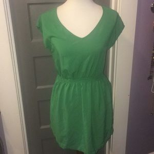 Tropical green summer dress with pockets.